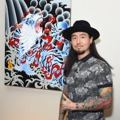 "Daisuke Sakaguchi with his painting, ""Inazuma"""