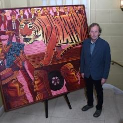 "John Gledhill with his painting, ""The Last Tiger"""