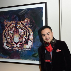 "Jacky Tsai with his artwork, ""Flying Tiger 1943"""