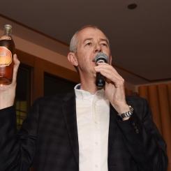 Simon Clinton holding Tiger Bone Wine